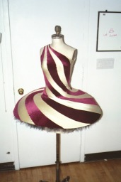 The entirely seamed cranberry velvet and ivory milliskin dress snaps onto a shaped high-density foam plate with a black classical tutu underneath.