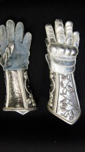 Armor gauntlet gloves with knuckles of blocked metallic leather bonded to varaform gauze.