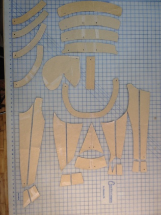 Prince's upper body armor pattern with cauldron (shoulder) bands on top right, gorget (neck) rungs top left, breastplate in the center and peplum across the bottom (pattern is left half of the body, left side is center front).