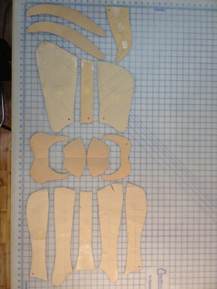 Prince's leg armor pattern with a couple sample faulds top left and codpiece top right, the three-part cuisse (thigh), the four-part poleyn (knee) and the five-part greave at the bottom.