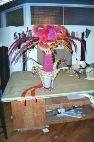 The feathers on Kitty's headdress detach for shipping and the central pagoda-shape accordions down as well.