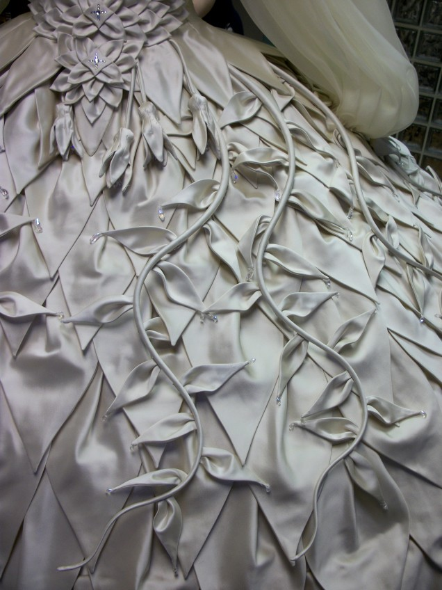 Skirt vine ornamentation structure is shaped piano wire, covered in tubular horsehair and duchess satin.