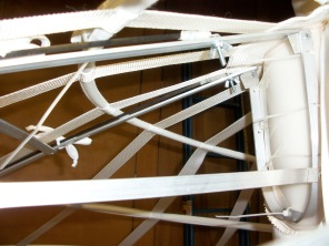 Carbon fiber rods extend from back hoop struts to lift the larger back of the hoop.