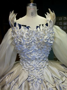 The bodice petals were bagged and turned shapes that were arranged into flowers before stitching them to the bodice.
