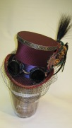 The top hat is made from a tip of plastic, a side band of heat-shaped altraform and fur felt brim.