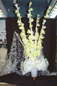 The gladiola petals are organza, individually shaped and the stems are supported with carbon fiber rod extended with piano wire.
