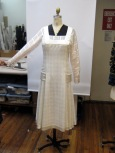 The 20's day dress has a net inner belt that connects hip sashes under the dress front and back