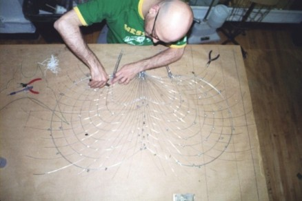 Weaving the piano wire for the standing butterfly veil and lashing the joins