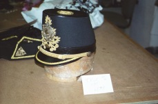 Side view of Kemp's oversized trick hat, lifted off after first bow, releasing hidden wig and beard that dropped into place for second bow