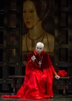 Philip Goodwin as Cardinal Wolsey at his demise in a brocade chimere, matching cassock and velvet mozzetta-his biretta is on the bench.